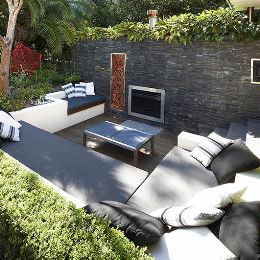 Amazing-Outdoor-Fireplace-with-Modern-Wall-Stone-also-Chic-Table-Design